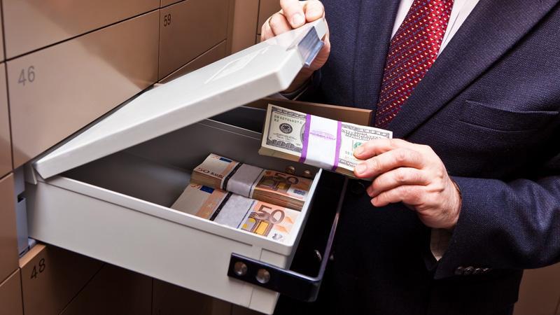 Как производятся расчеты по недвижимости с помощью банковской ячейки